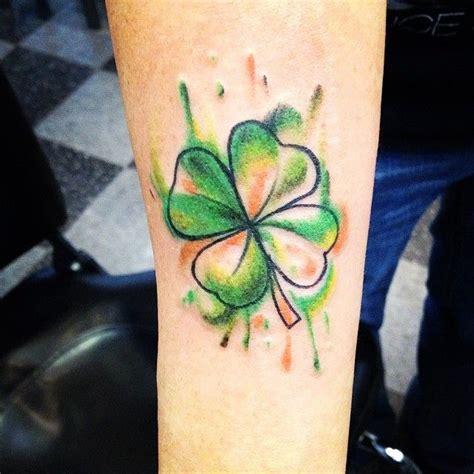arm sleeve green ink shamrock leaf tattoo