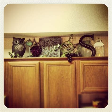 How To Decorate Cupboard by 17 Best Ideas About Above Cupboard Decor On