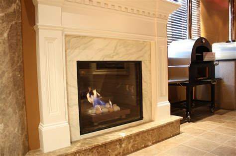 what to look for in a kitchen sink mantels give an fireplace a new look 2246