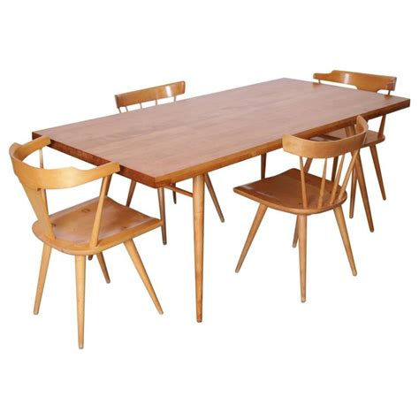 maple dining table set paul mccobb dining set four chairs and table maple 1950s