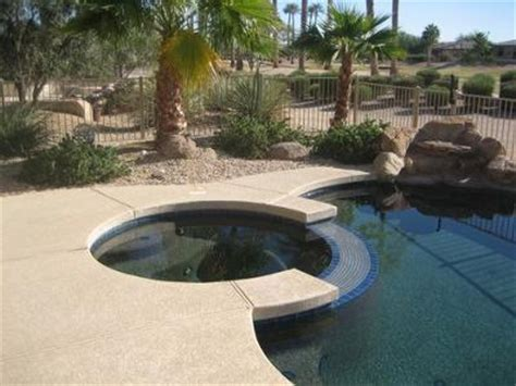 Travertine Pavers Over Concrete Kool Decking Around Pool. Seafoam Green Bedding. Modern Tv Wall Unit. Stone Floors. Outdoor Home Lighting. Landscaping With Stone. Find Bookmarks. Traditional Bathroom Designs. Endless Pool