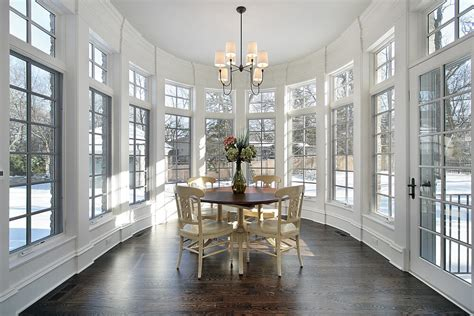 Large Oval Room With Wraparound Frame Windows And White