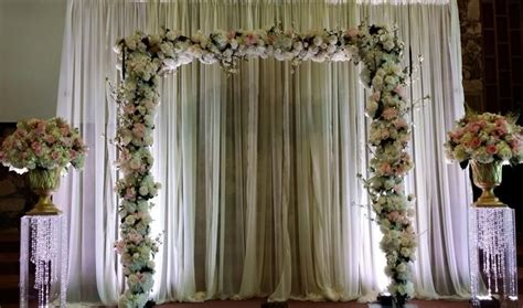 Simple Pipe And Drape Backdrop With Square Arch, Full Of Flowers And Flanked By Two Large Altar Curtains For Baby Room Australia Shower Curtain Bamboo Print How To Put Over Vertical Blinds Blue Bedroom Uk Gray And White Darkening Zebra Bedding Do You