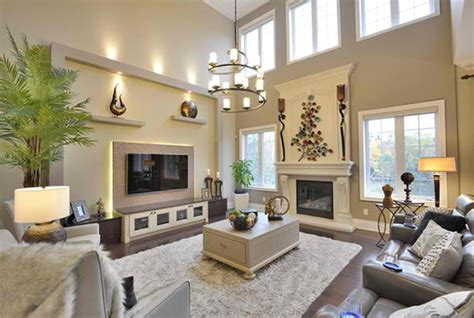A large, windowless wall is the perfect canvas for creative decor. TV wall | High ceiling living room