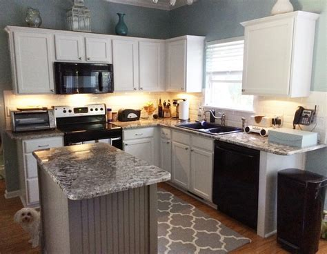 Kitchens With White Cabinets by White Cabinets With Dovetail Gray Island 2 Cabinet