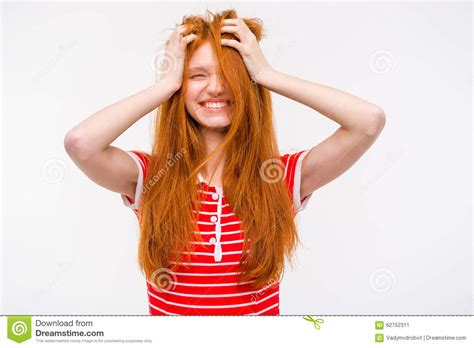 Funny Girl With Messy Tousled Hair Holding Hands To Head