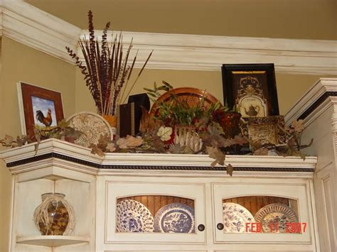 decorating ideas for above kitchen cabinets decorating ledges plant shelf ideas