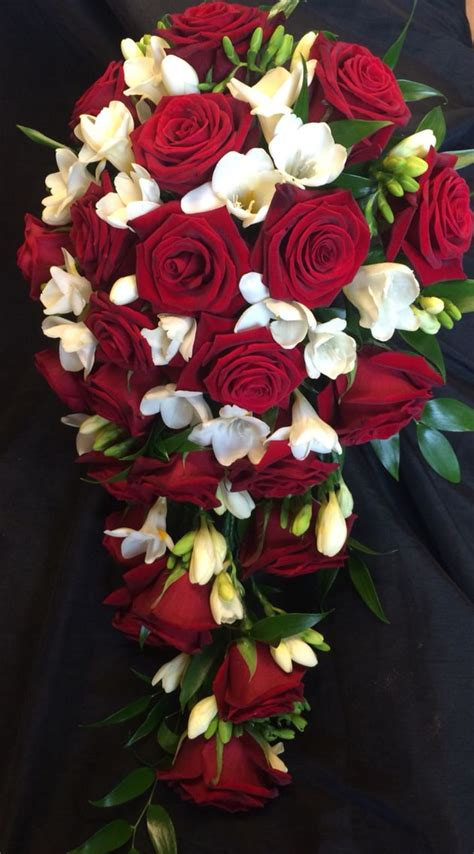 red rose  freesia shower bouquet  christmas colours