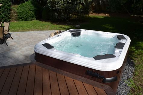 tub bullfrog spas with trex deck and cambridge paver