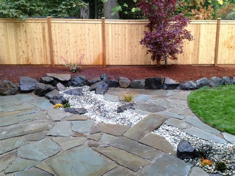 persnickety landscaping outdoor patio with dry creek bed yelp