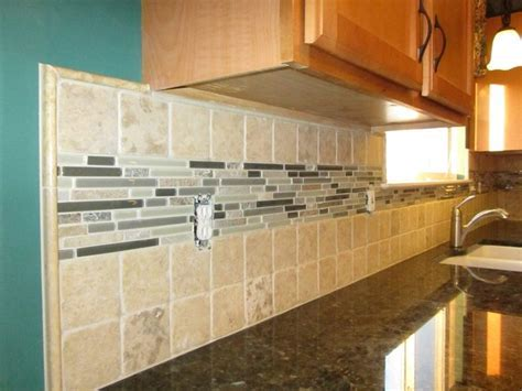 Backsplash: Stone 4x4 tiles with a large glass and stone