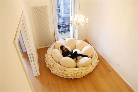birdnest wooden bed filled with egg shaped pillows