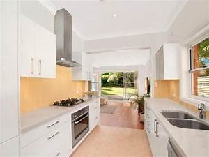 Modern galley kitchen design using floorboards - Kitchen