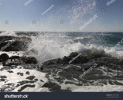 Ocean Waves Crashing On Rocks Stock Photo 522921565