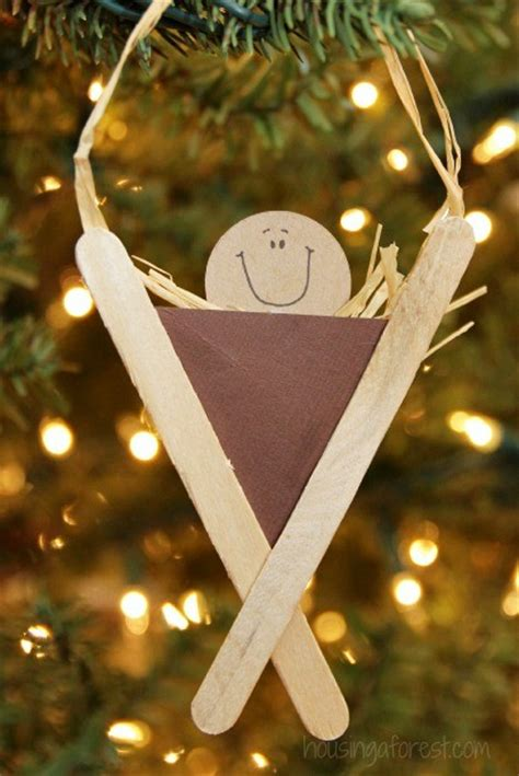 popsicle stick manger craft housing a forest