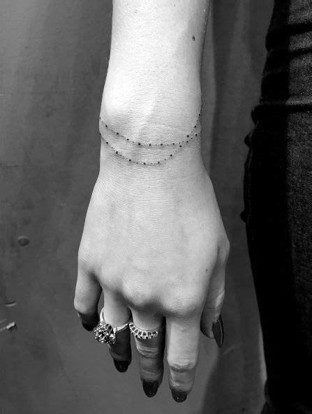Bracelet tattoo by Daniel Winter | Wrist tattoos for women, Small wrist tattoos, Wrist bracelet