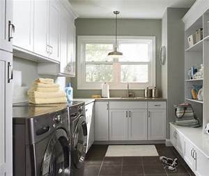 Laundry room cabinets in painted white maple masterbrand for Best brand of paint for kitchen cabinets with wall art for laundry room