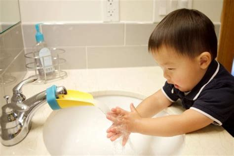 aqueduck faucet extender 19 practical and ingenious bathroom gadgets keep up with