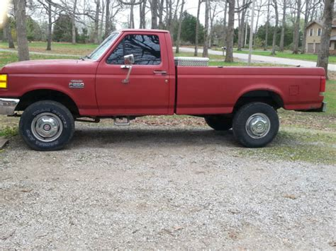 red  ford   ton  wheel drive truck