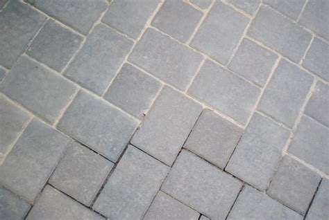 how to use polymeric sand to block weeds in our paver