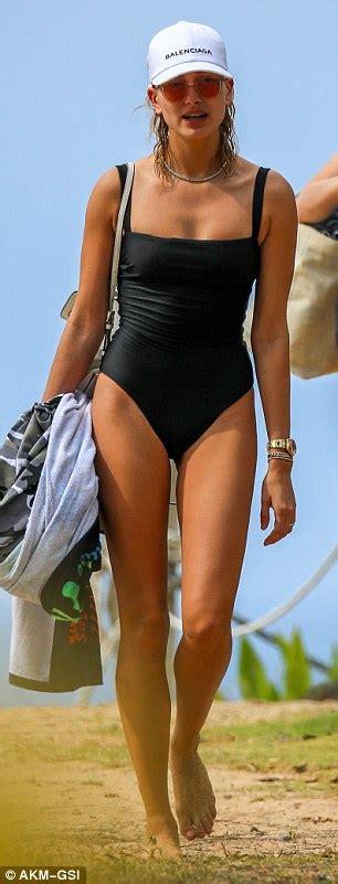 hailey baldwin wears modest black bathing suit  hawaii