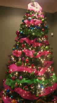 on pink and green mantel and tree decor