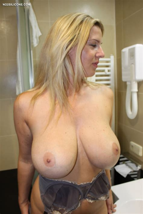 blonde wife shows big naturals in the bathroom