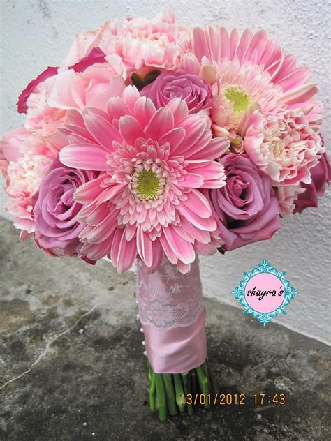 roses carnations gerbera daisies would add calla lilies