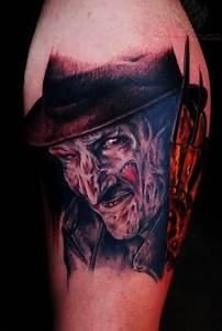Simple Colored Freddy Krueger Tattoo On Left Arm
