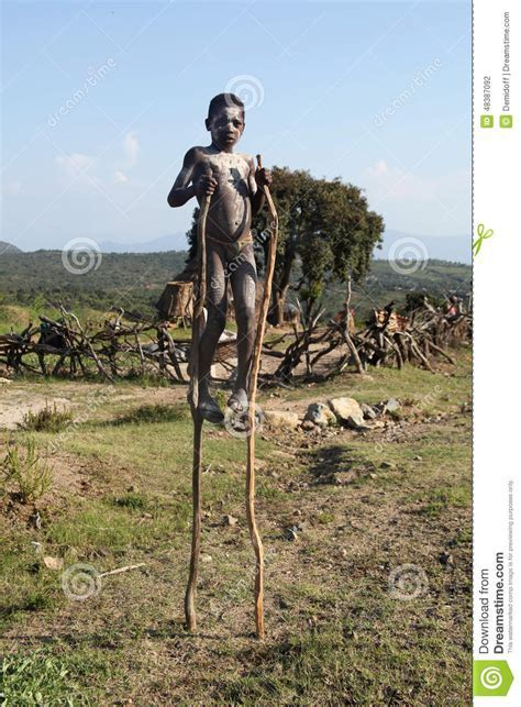 The African Boy On Stilts Editorial Photography Image Of Banna