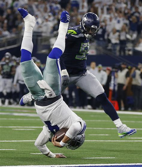 elliott cowboys top seahawks colts advance  nfl