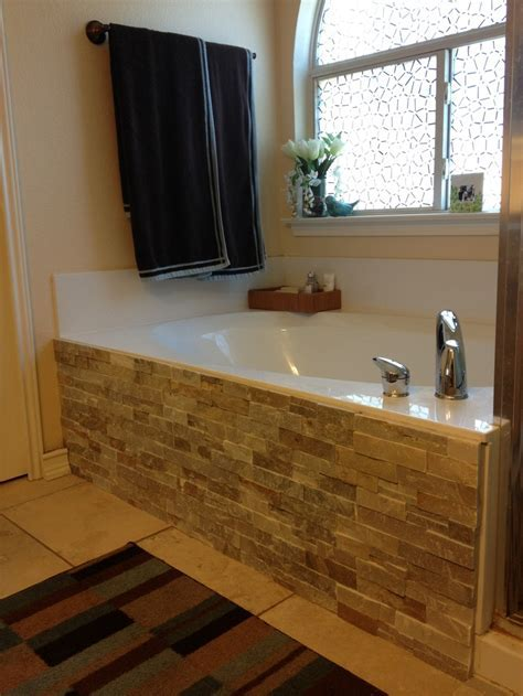 Backsplash tile and adhesive glue to the side of our