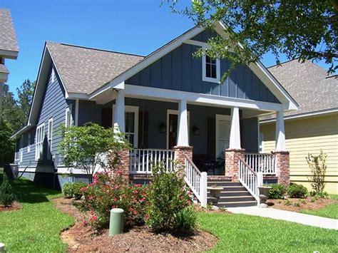 ranch craftsman floorplan brick porch columns black shutters  pane windows cottage house