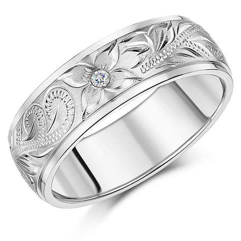 couple titanium wedding rings hand engraved cz