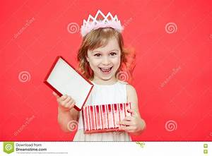 Happy Kid Opening A Gift Box On Red Background Stock Photo ...
