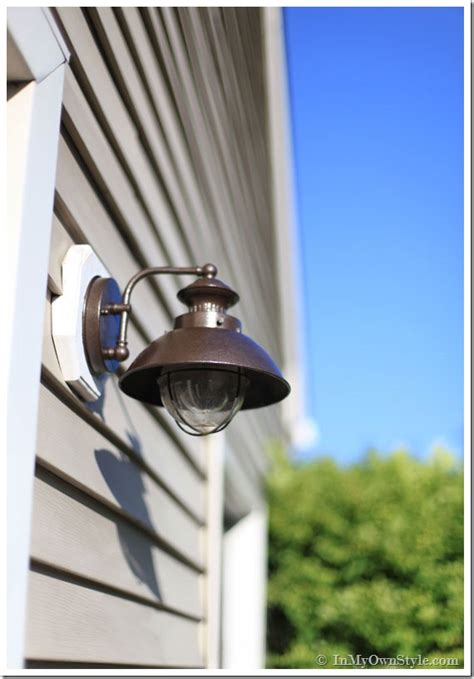 outdoor light fixture makeover using metallic paint