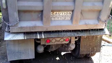 fast tri axel dump truck tailgate spread overshoots  gravel driveway youtube
