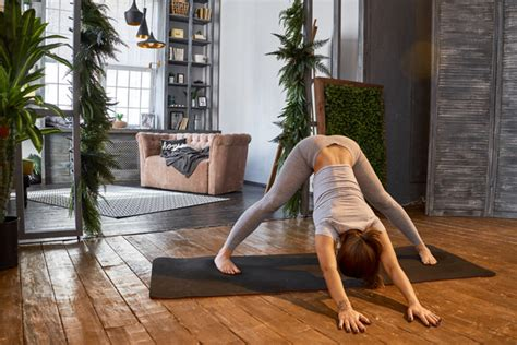 Woman Practicing Yoga In The Living Room Stock Photo 03. Basement Fans Humidity. Install Basement Toilet. Flooring Basement. My Parents Basement. Basement Closet Doors. Game Room Ideas For Basements. Remodeling Basement Stairs. Bungalow House Plans With Basement And Garage