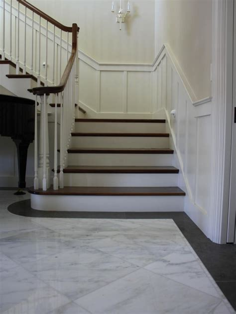 sweeping staircase  marble entry hgtv