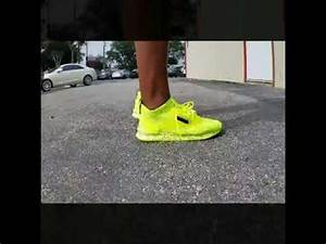 Neon Green reebok zoku runner on feet