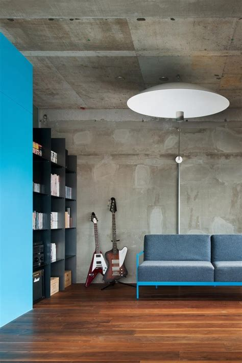 industrial minimalist interior minimalist and industrial apartment design with turquoise accents digsdigs