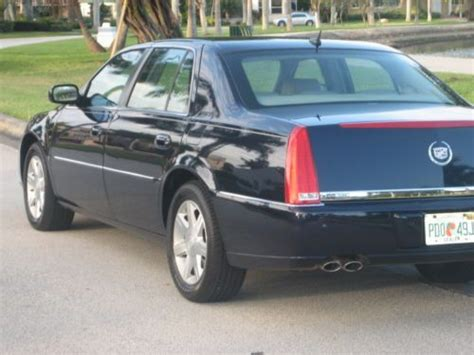 sell     cadillac dts loaded  smoker clean