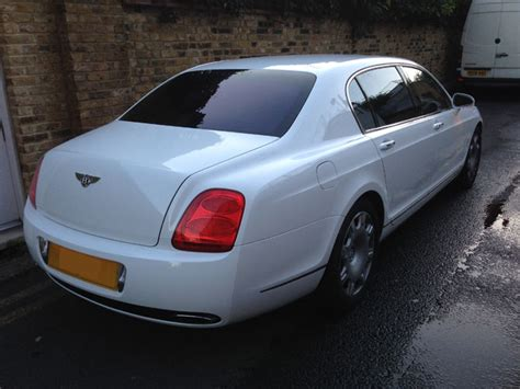 white bentley flying spur bentley flying spur wrapped white by wrapping cars london