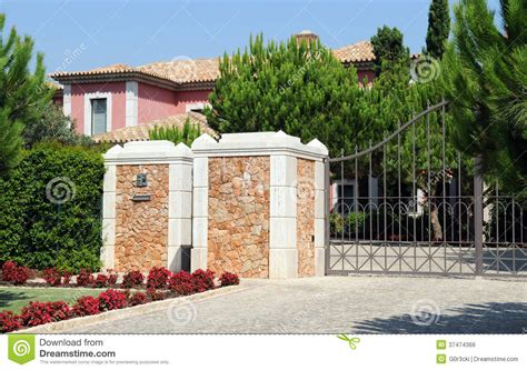 Bid Electronics Front Gate From A Big Pink Residence Stock Photo Image