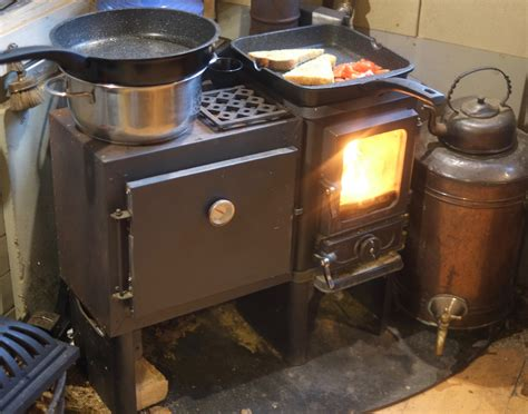 Baking cupcakes using a small wood cook stove