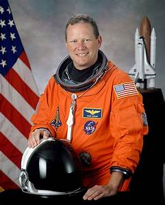 File:David M. Brown, NASA photo portrait in orange suit ...