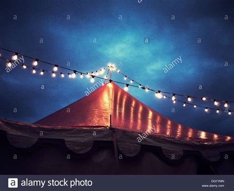 circus tent and string of lights at night low angle view