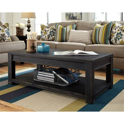 In reality, however, black furniture, such as black coffee table sets, can actually brighten up your room by bringing attention to the lighter pieces of furniture that you have. Signature Design By Ashley Gavelston Black Rectangular ...