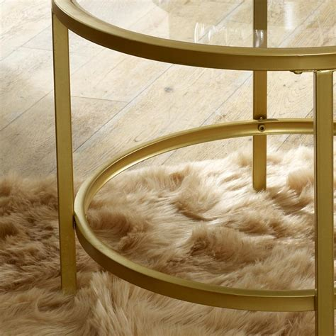 The most common glass gold coffee table round material is glass. Vintage Gold Round Glass Top Coffee Table - Melody Maison®