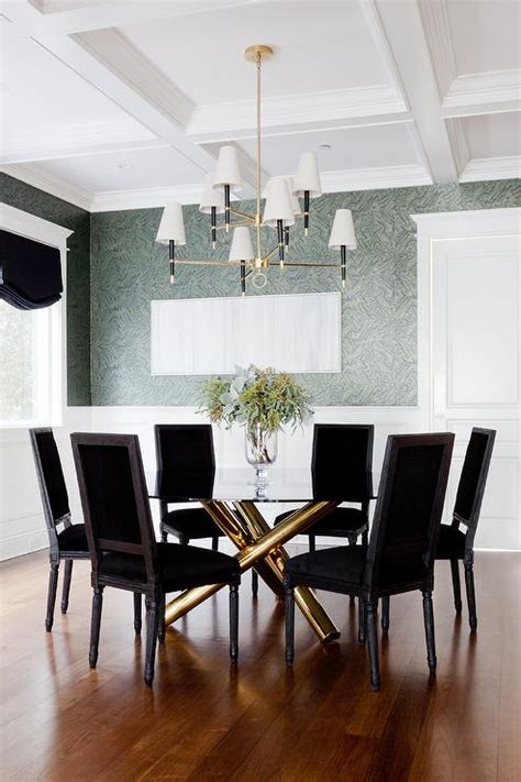 gold dining table with black velvet dining chairs